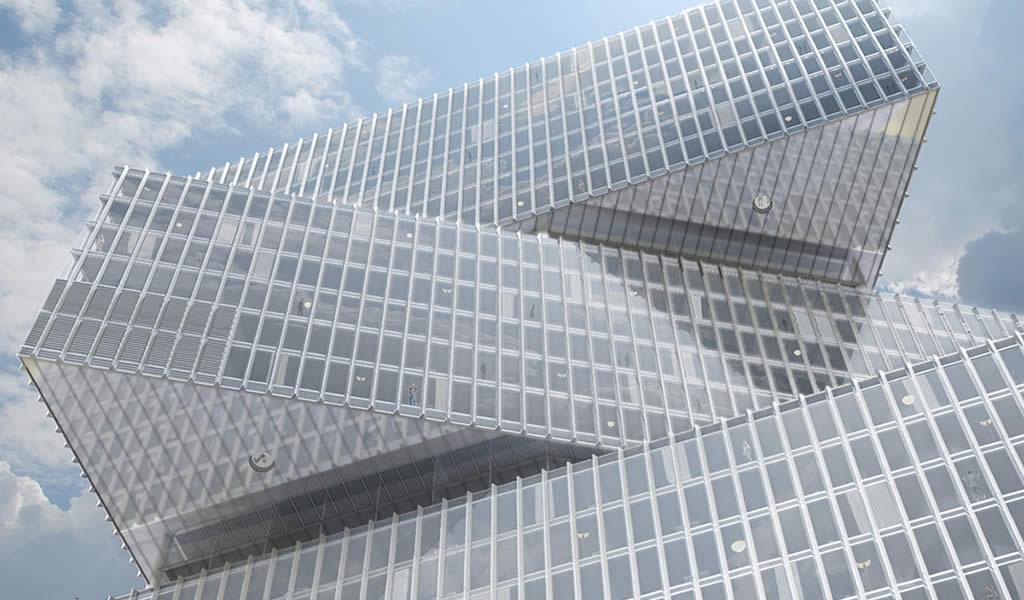 Tres volúmenes triangulares de vidrio, el último edificio de OMA / Reinier de Graaf