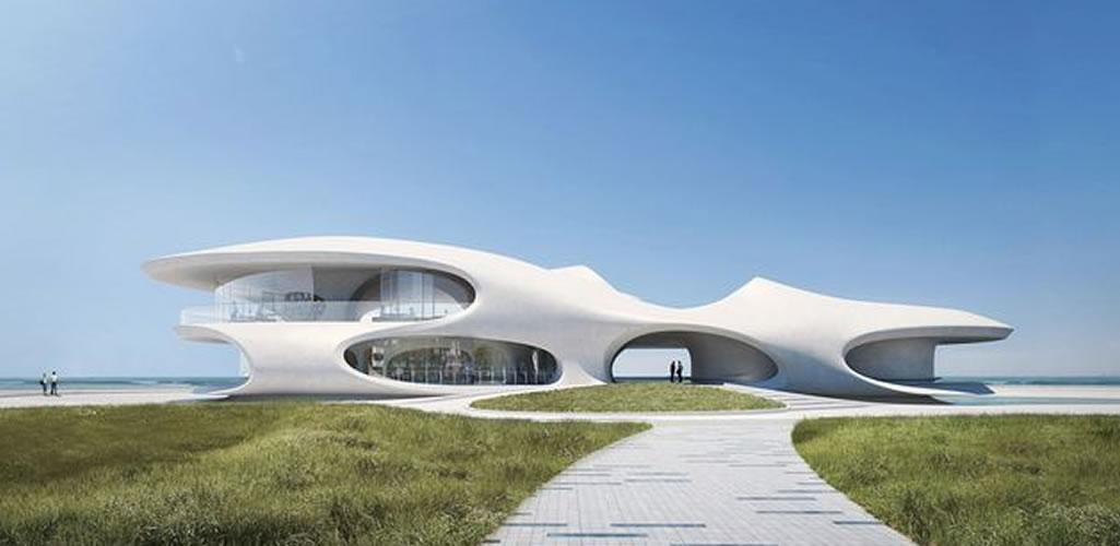 Una biblioteca con estructura curva y vistas al mar